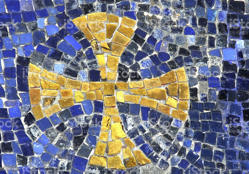 Mosaic of a golden cross with a blue background stock photo