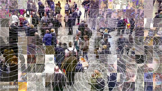 Crowd of people with a mosaic digitized effect and radio waves from smart phones.