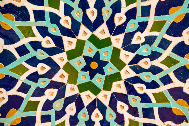 Mosaic wall decoration, Friday Mosque, Yazd, Iran Decorativ roundel made of tiles in the famous Friday Mosque in Yazd, Iran. This mosque (in local language called Masjid-e Jame) was built in the 14th century a.d. and is one of the main touristic highlights in the desert town of Yazd. persian culture stock pictures, royalty-free photos & images