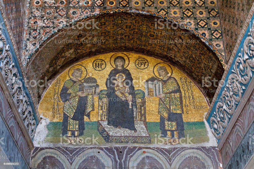 Istanbul, Turkey - May 24, 2014: Mosaics inside of Hagia Sophia in Istanbul, Turkey. The mosaic panel represents Emperor Justinian, Virgin Mary, Jesus Christ and Emperor Constantine. stock photo