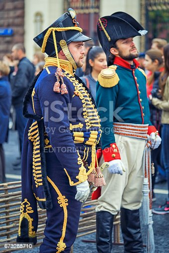 istock Moscow, Russia - September 11, 2016: Moscow City Day, 869 anniversary of the city. Performance on Tverskaya Street. French soldiers Napoleon era in a uniform in the street. 673288710