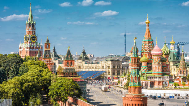 Moscow Kremlin and Cathedral of St. Basil on Red Square Moscow Kremlin and Cathedral of St. Basil on the Red Square, Russia. Panoramic view. The Red Square is the main tourist attraction of Moscow. moscow russia stock pictures, royalty-free photos & images