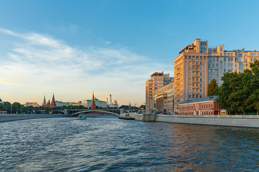 Moscow Kremlin and other buildings on the embankment of the Moscow river in the evening.