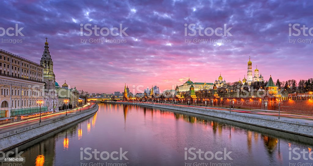 Moscow Kremlin and the Sofia embankment with a red sunset stock photo