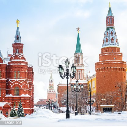 Moscow Kremlin in winter, Russia. It is a top tourist attraction of Moscow. View of Manezhnaya Square in the Moscow center during snowfall. Old Moscow city under snow.