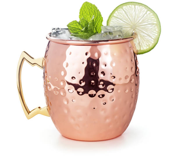 moscow mule cocktail in a copper mug isolated on white stock photo
