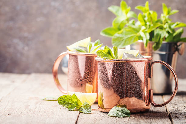 Moscow mule cocktail Moscow mule cocktail in copper cup with lime, ginger beer, vodka and mint garnish mule stock pictures, royalty-free photos & images