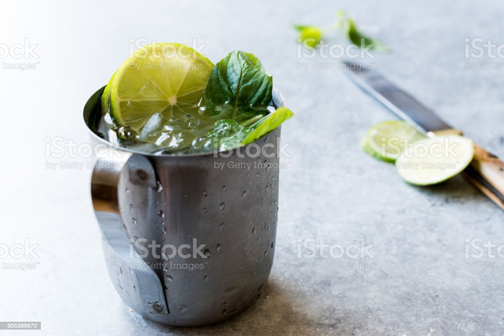 Moscow Mule Cocktail with Lime, Mint Leaves and Crushed Ice in Metal Cup. - Zbiór zdjęć royalty-free (Alkohol - napój)