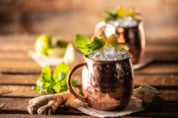Moscow Mule highball cocktail and a long vodka drink with fresh lime, ginger beer, and mint. stock photo