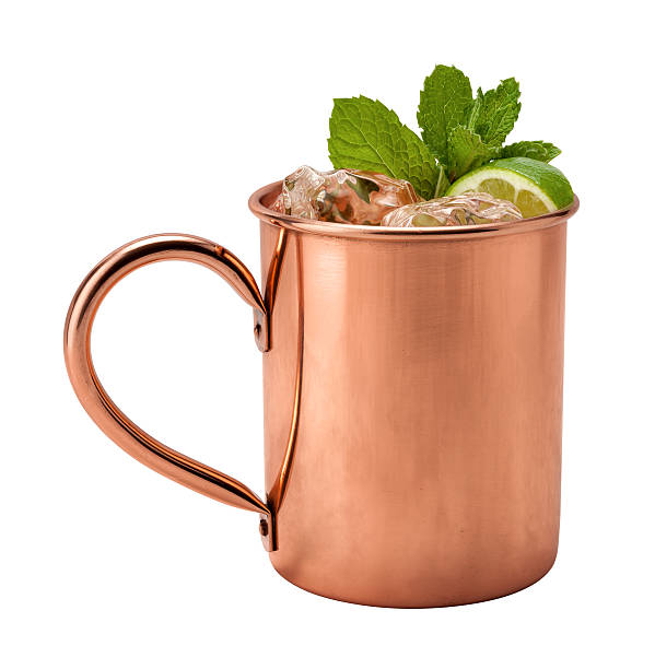 Moscow Mule in a Copper Mug Moscow Mule in a Copper Mug. This is a Vodka drink served with mint, and a garnished with a wedge of lime, The image is a cut out, isolated on a white background, and includes a clipping path. moscow russia stock pictures, royalty-free photos & images