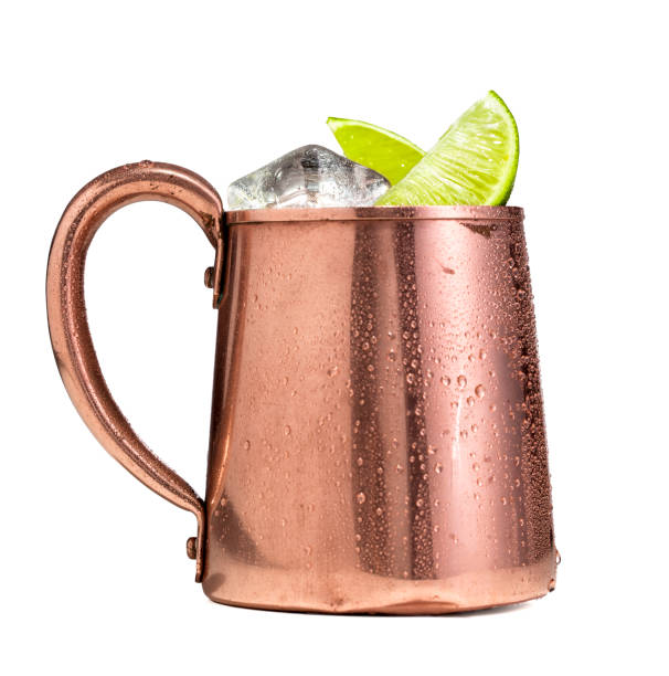 Moscow Mule Vodka Ginger Beer Copper Cup A Moscow mule drink in a copper cup on a white background.  Moscow mules are made with vodka, ginger beer, and lime and served over ice in a copper mug. moscow russia stock pictures, royalty-free photos & images