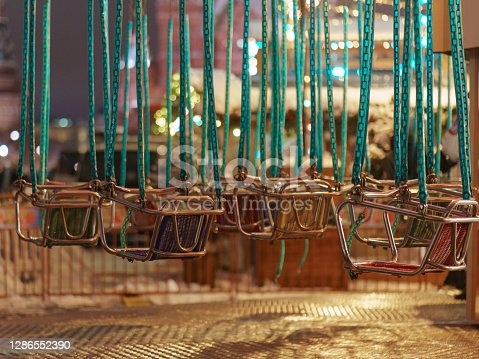 Go around carousel in the Red Square in winter 2019 evening. Holidays festive mood