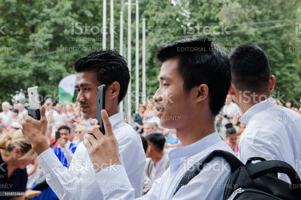 Moscow, Russia, 04 august 2018 Unknown Balinese young guys take a picture at the festival of Indonesia stock photo