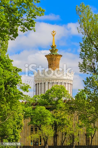 Moscow, Russia 12.05.2016 pavilion Agriculture, the former tower of the Ukrainian in the form of a crown with a star surrounded by green trees.