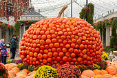 12-10-2019, Moscow, Russia. Holiday Golden Autumn. A huge pumpkin collected from small orange pumpkins, a festive decoration in the center of the capital. Vegetable Harvesting Event