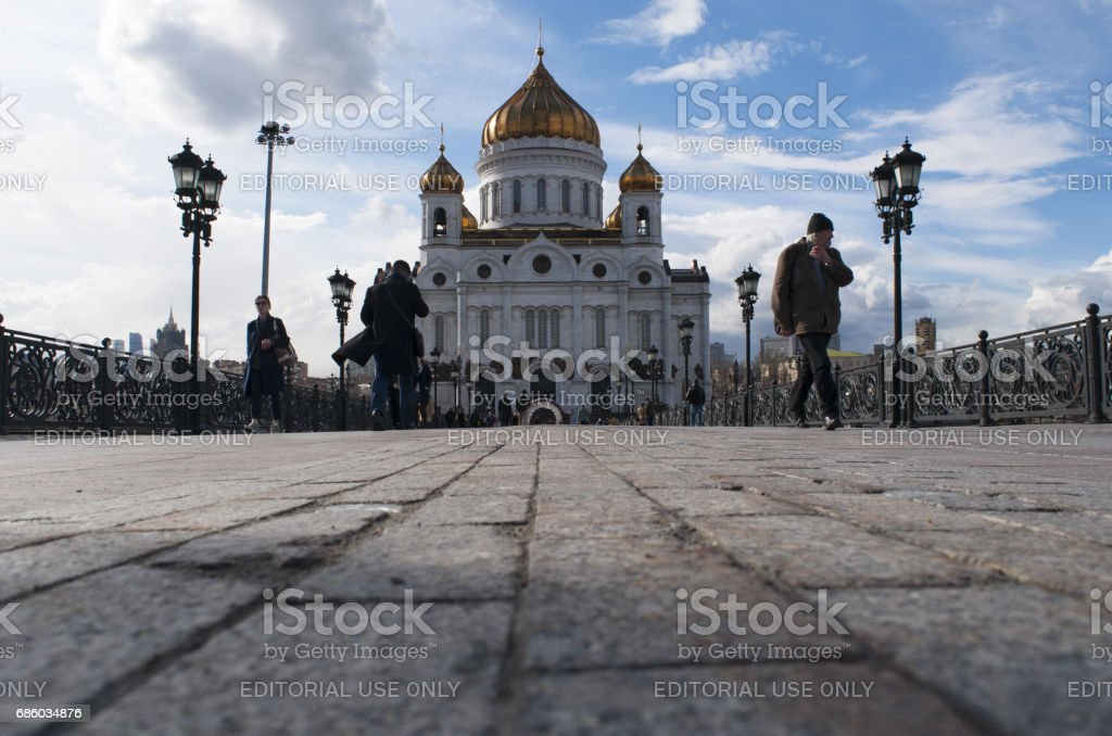 Moscow, Russia: tourists and local people walking on the Patriarch Bridge with view of the Cathedral of Christ the Saviour stock photo