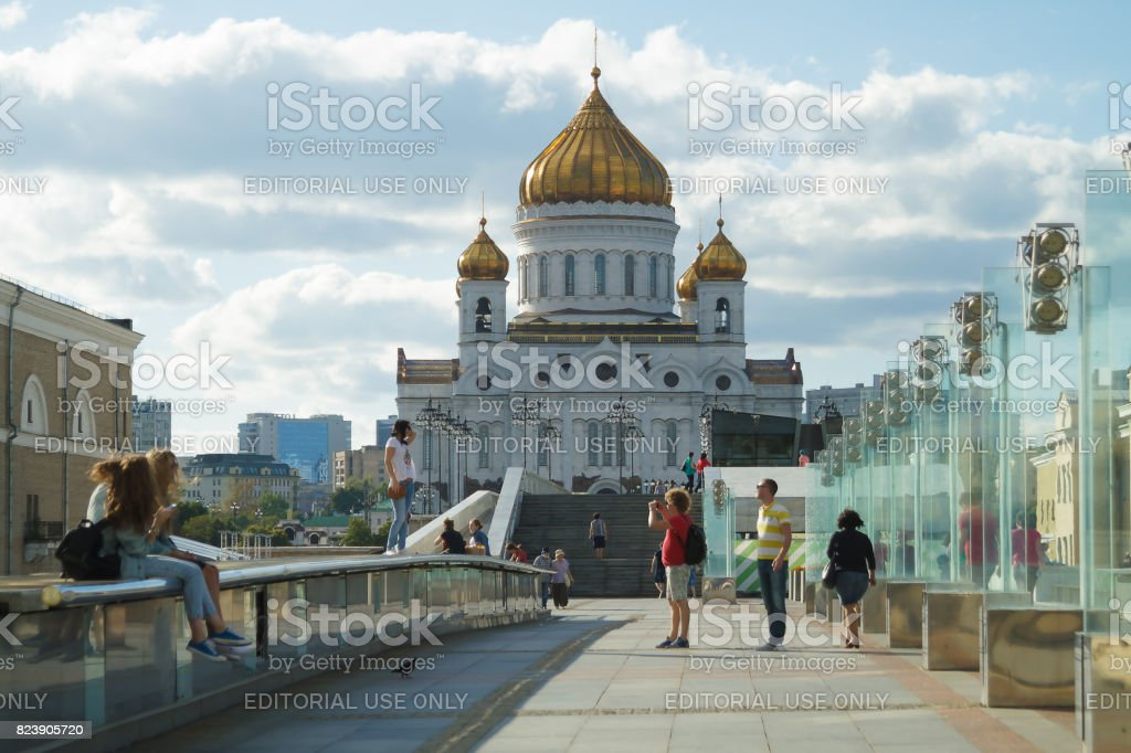 Moscow. Russia. View on Christ the Savior Cathedral. Famous place visiting by plural tourists men and women youth and elderly. stock photo