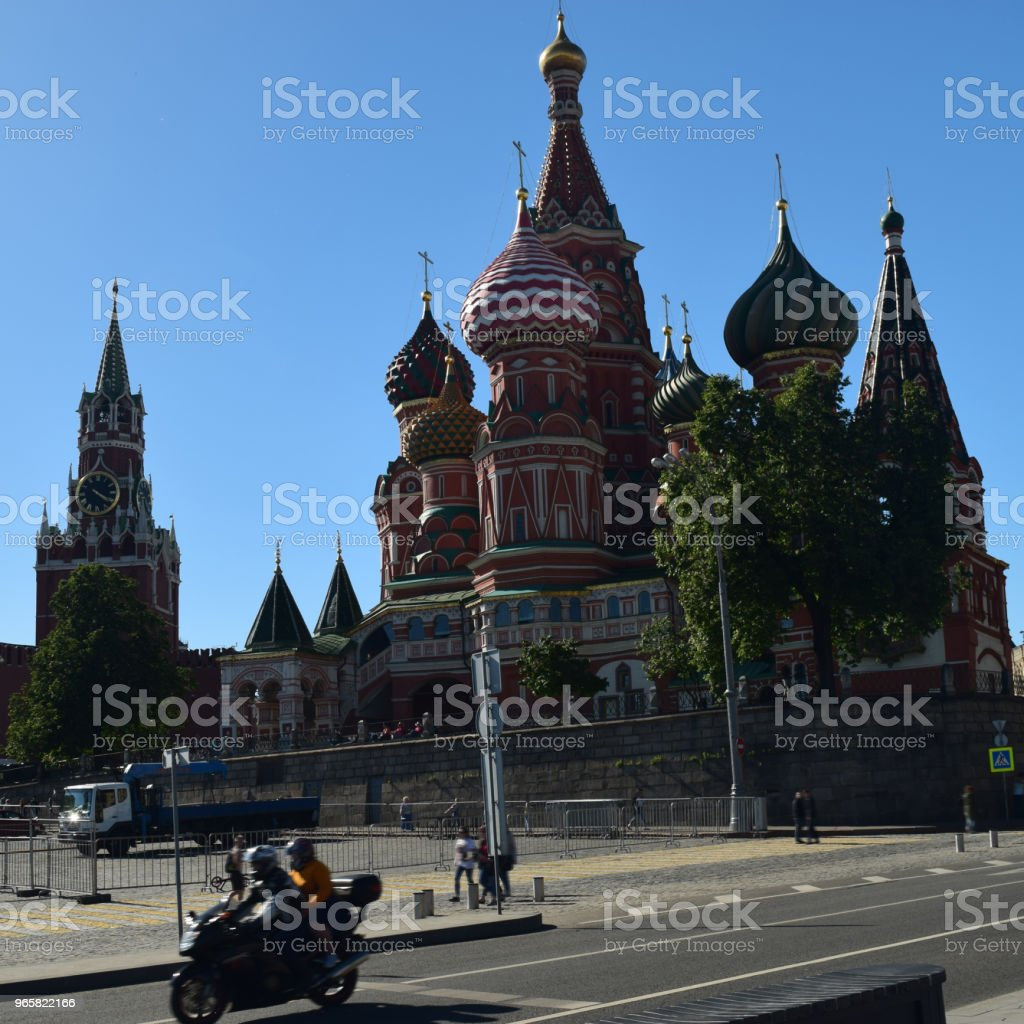 Moscow St Basil's Cathedral and moving motorcycle. - Royalty-free Ancient Stock Photo