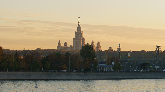 Moscow,  Russia - October 7, 2021: Photography of Moskva river, Moscow State University in Stalinist neoclassical style named after Mikhail Lomonosov. Gold sunset over the Moscow.