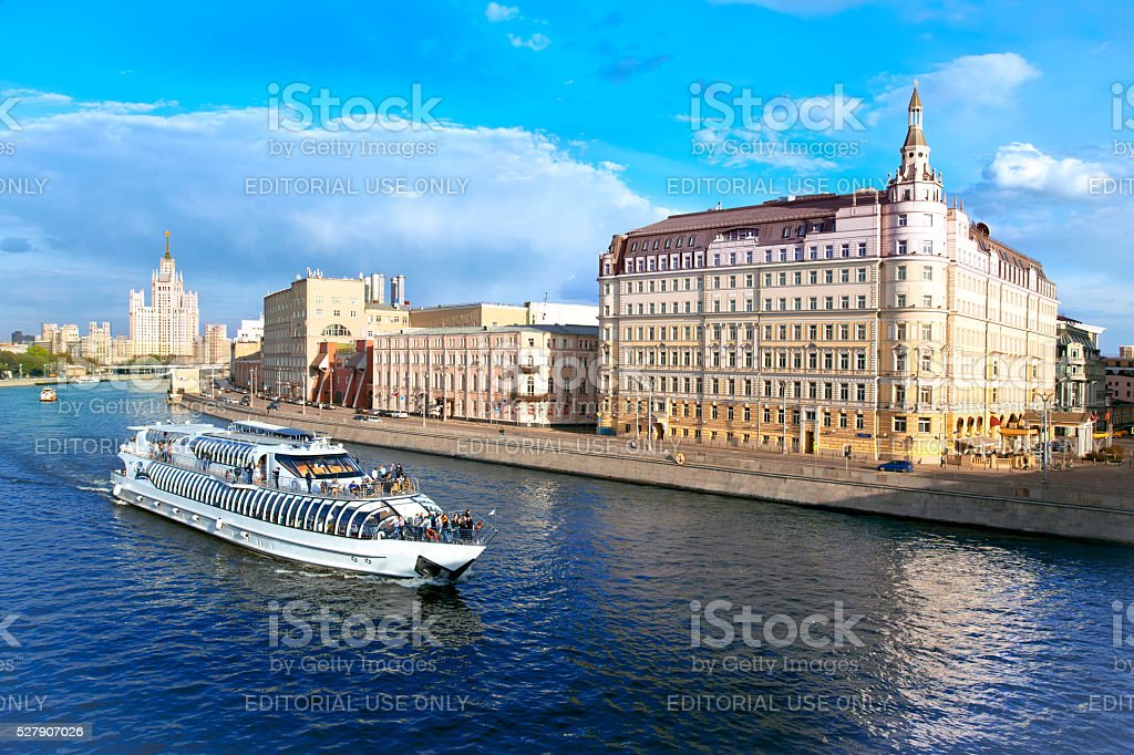 Moscow. View of river with passenger boat,  Baltschug Kempinski Hotel stock photo
