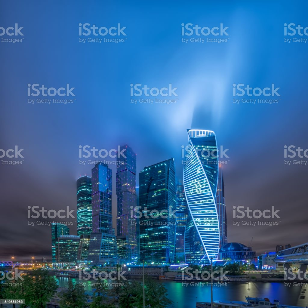 Moscow-city at night in the fog and at low clouds stock photo