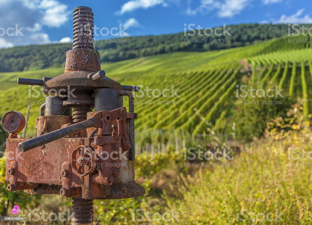 moselle vineyard and antique vine Agriculture machine royalty-free stock photo