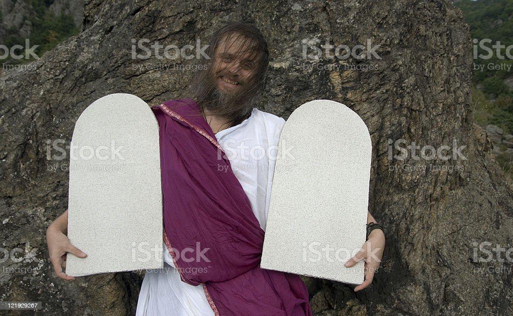 Moses mit Steintafeln lacht stock photo