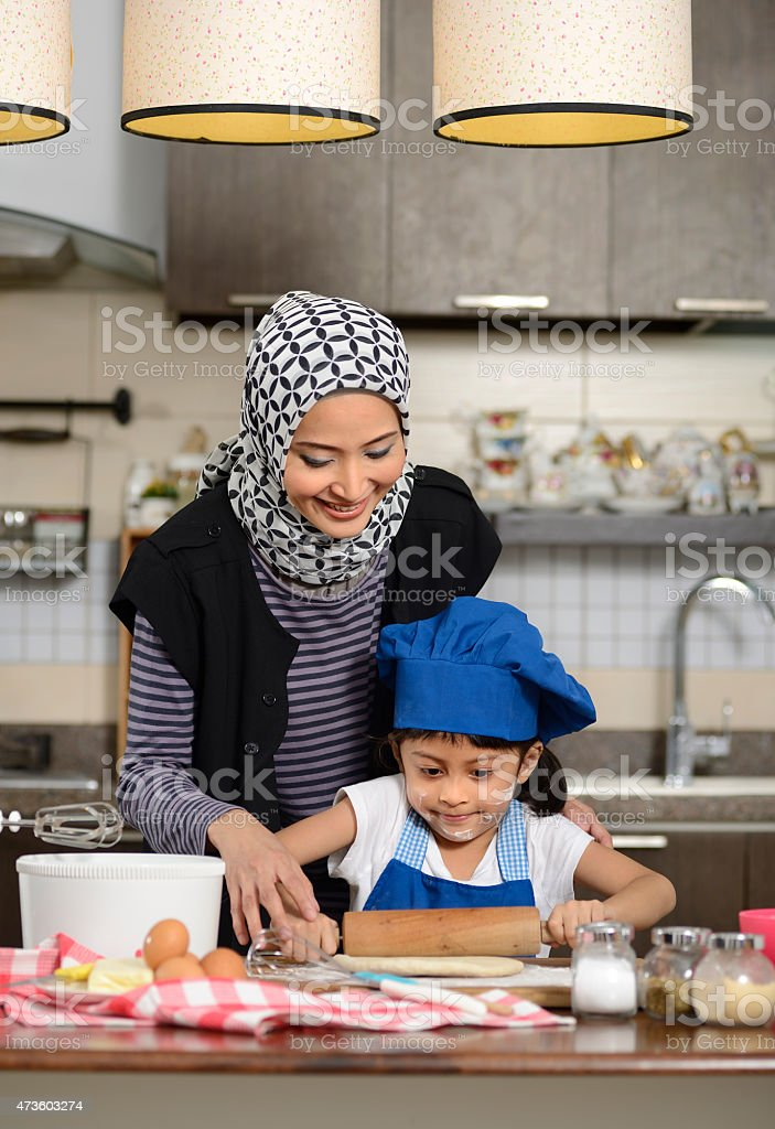 Moslem Woman Teaching Her Daughter stock photo