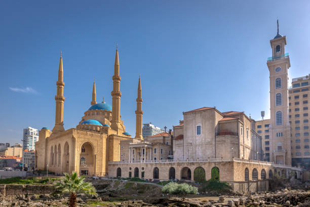 a mosque and a church together in beirut, capital of lebanon in a blue sky day - beirut foto e immagini stock