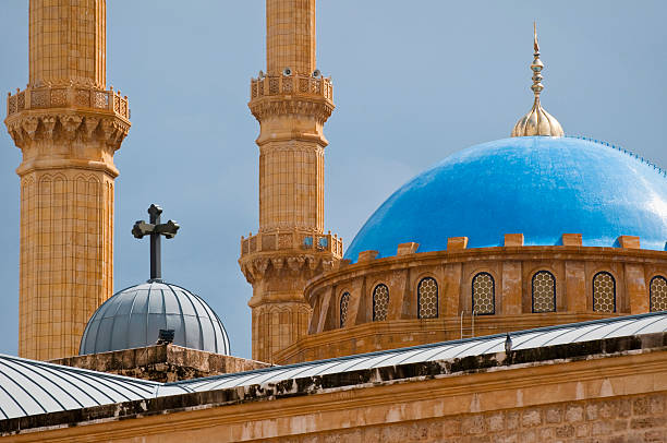 Mosque and church juxtaposed in Beirut, Lebanon The rooftops of the St. George Orthodox Cathedral and the Mohammad Al-Amin Mosque minutes after a rainstorm in Beirut, Lebanon beirut stock pictures, royalty-free photos & images