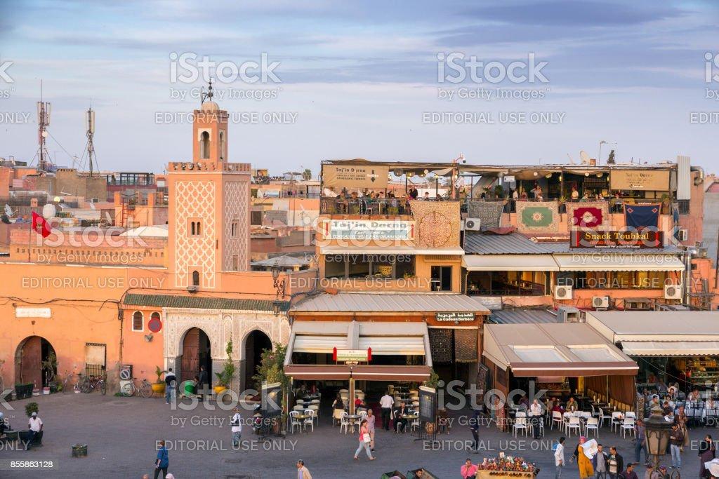 Mosque and restaurants Marrakesh Morocco stock photo