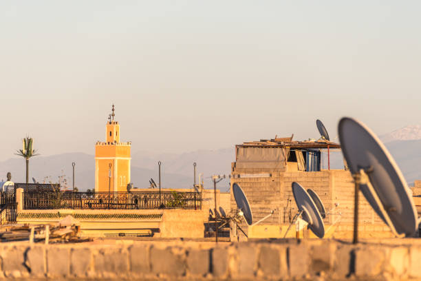Mosque and rooftops at sunset in Marrakesh, Morocco stock photo