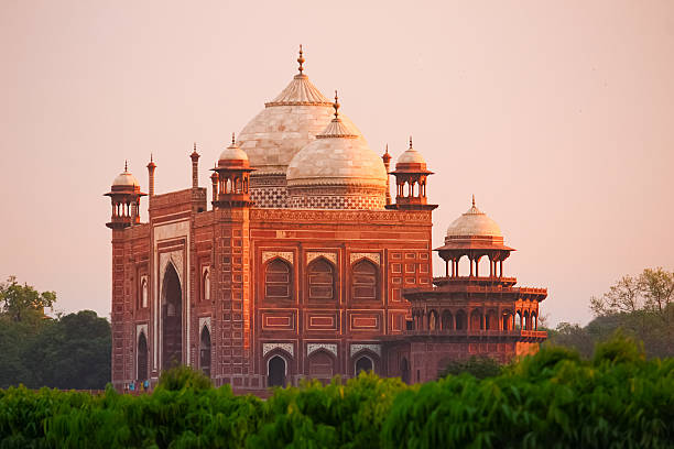 Mosque at Taj Mahal in Agra India Photo of the mosque made of red sandstone at the Taj Mahal in Agra, India at sunset agra stock pictures, royalty-free photos & images