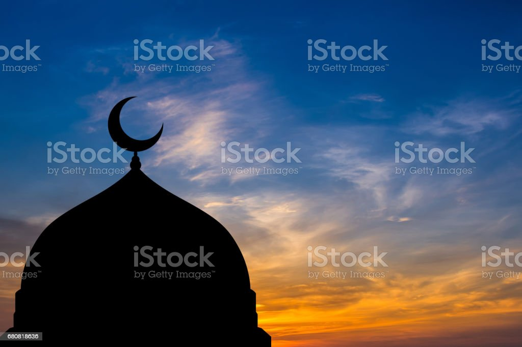 Mosque dome silhouette  in Twilight time stock photo