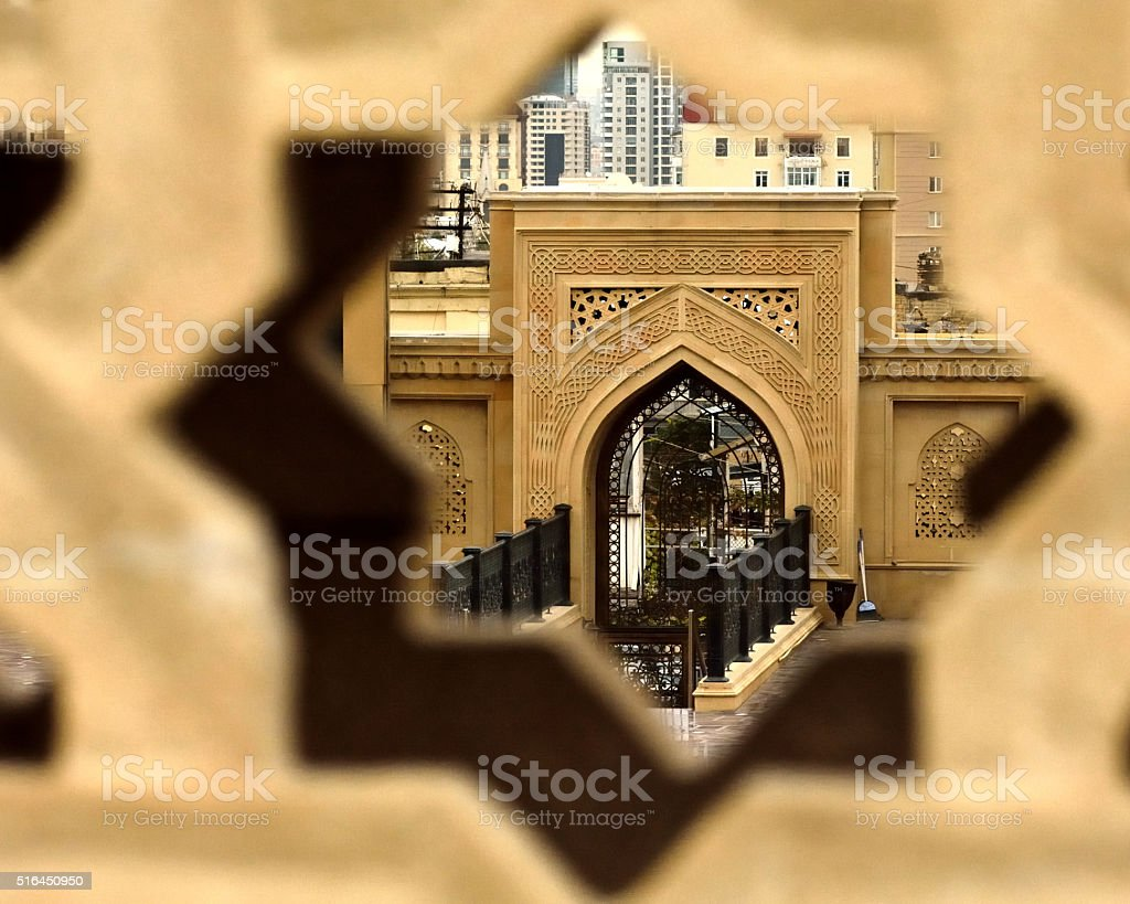 Mosque grounds viewed through star in wall stock photo