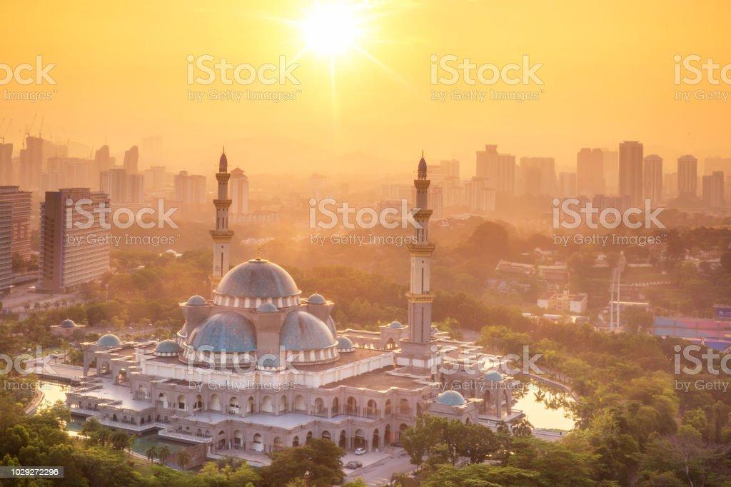 Mosque in Kuala lumpur with morning sunrise time in Kuala lumpur city stock photo