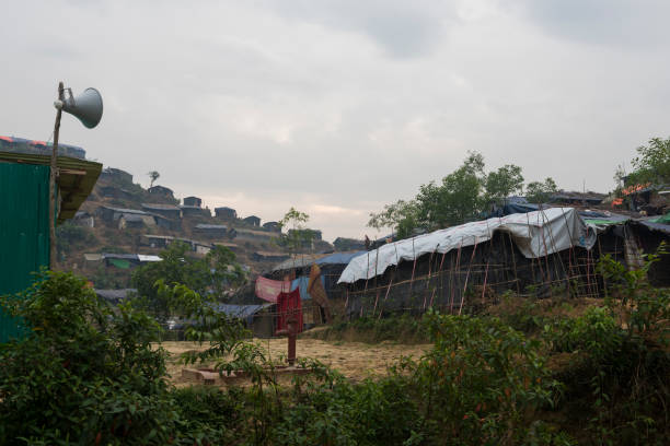 Mosque loudspeaker at Rohingya refugee camp in Bangladesh A loudspeaker stands outside a mosque built among the numerous rustic shelters for Rohingya Muslims at Chakmarkul refugee camp in Bangladesh (October 28, 2017) rohingya culture stock pictures, royalty-free photos & images