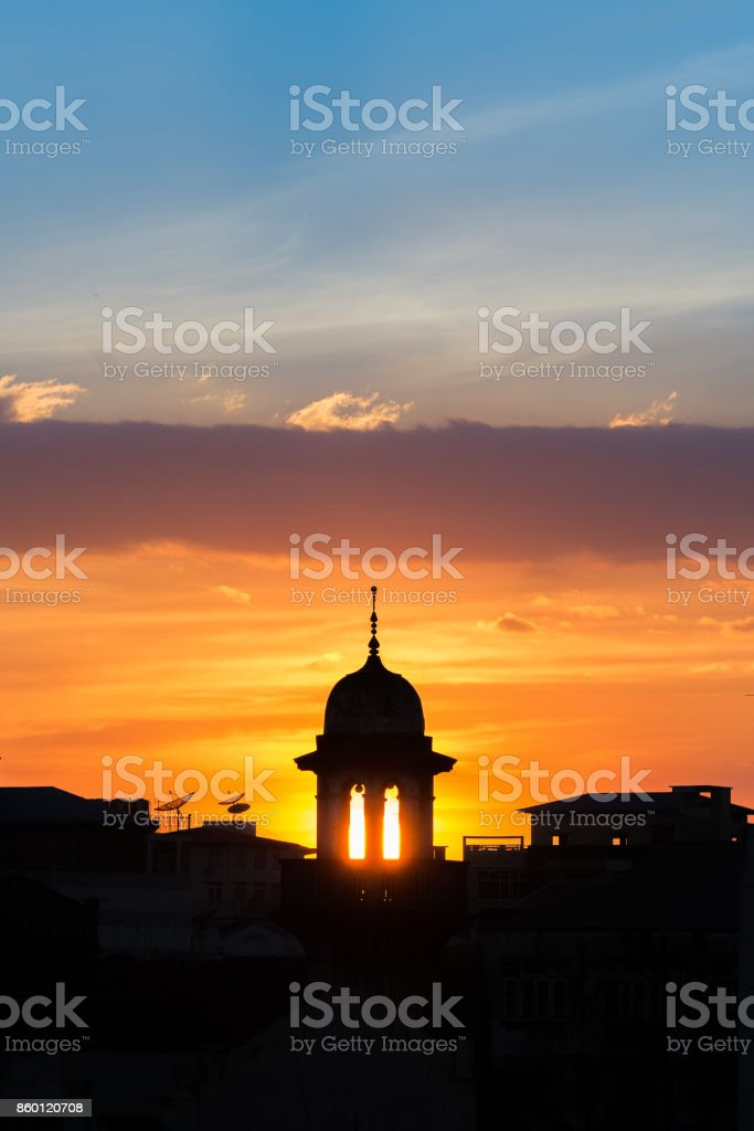 mosque silhouette with beautiful sunset background.mosque is more than a place of worship, study and discuss Islam,community centres,teach about muslim,religious festivals or Weddings stock photo
