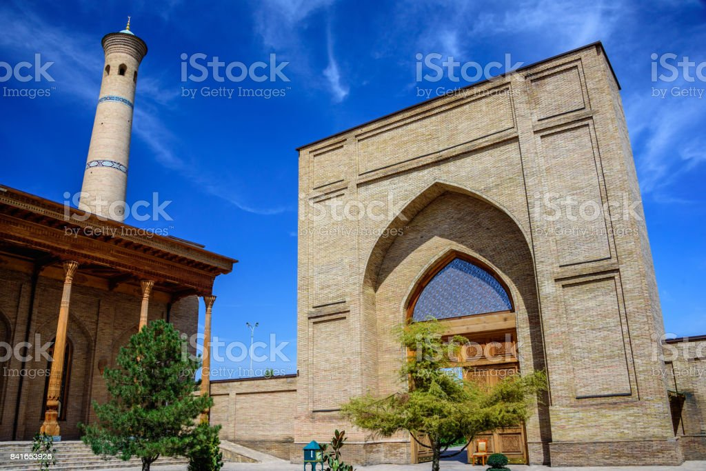 Mosque with carved columns of sandalwood, minaret and entrance of Hazrat Imam Ensemble in the center of Tashkent city stock photo