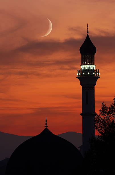 Mosque with crescent moon at dusk This is a photo of a beautiful mosque in sunset  minaret stock pictures, royalty-free photos & images