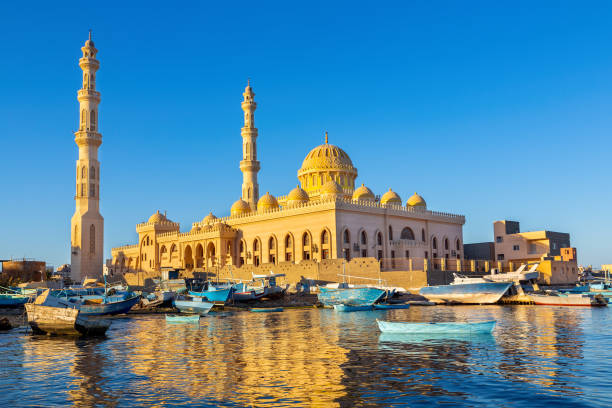 Mosque with fishing boats at sea in egypt stock photo