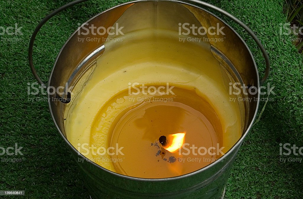 Mosquito citronella candle in a pail for camping royalty-free stock photo