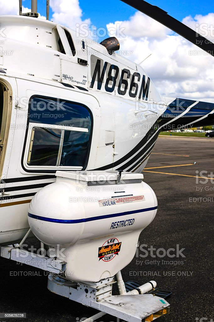 mosquito control pesticide unit attached to a helicopter stock photo