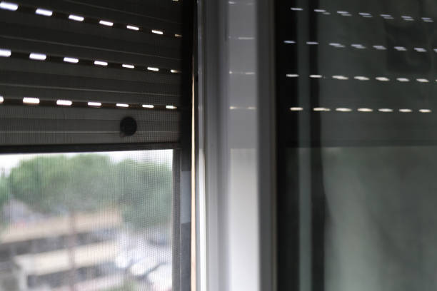 Mosquito net on a PVC window - foto stock