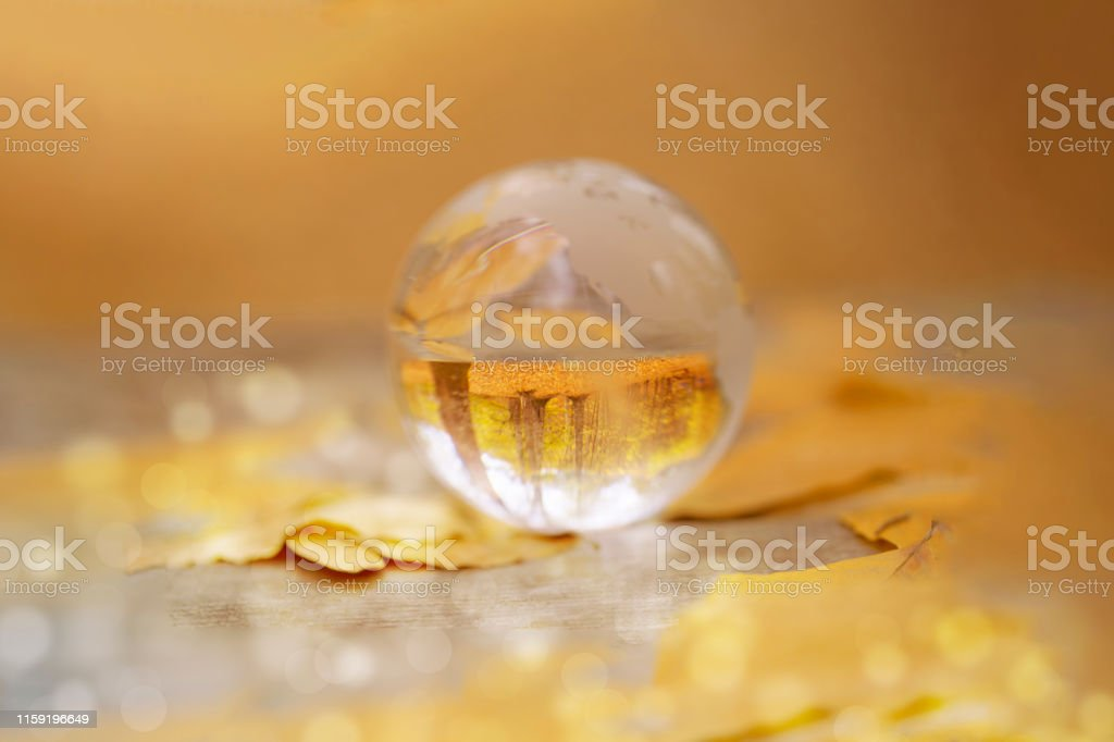 Crystal ball reflecting on Earth\'s sphere