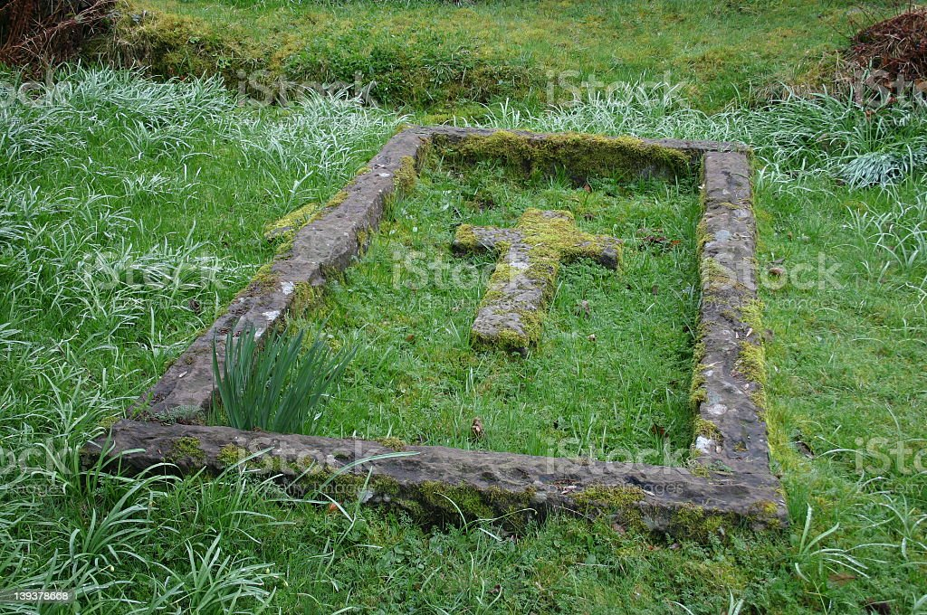 Moss covered grave royalty-free stock photo