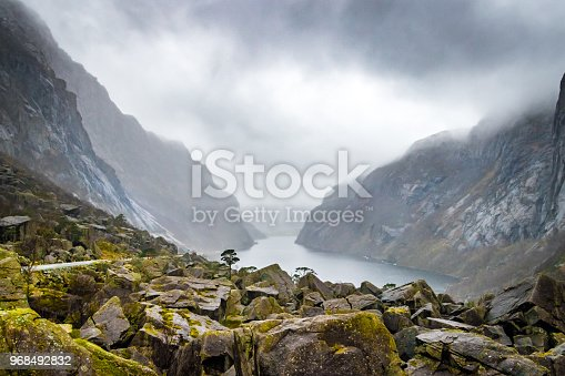 Moss covered green rocks fjord Norway bad weather