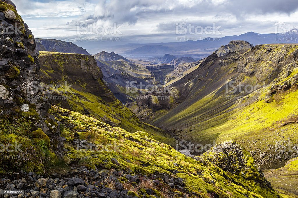 Moss covered valley on Fimmvorduhals, Thorsmork in the distant. stock photo
