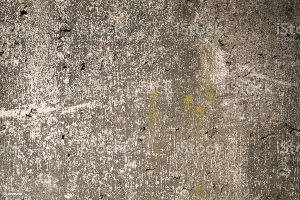 Mossy gray rough concrete wall texture royalty-free stock photo