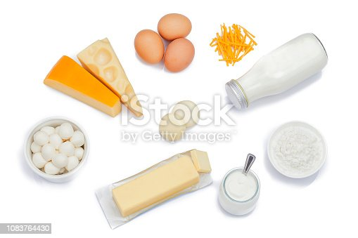 Top view of most common dairy products shot on white background. Dairy products included in the composition are milk, various cheeses, yogurt, cottage cheese, butter and eggs. Predominant colors are white and yellow. High key DSRL studio photo taken with Canon EOS 5D Mk II and Canon EF 100mm f/2.8L Macro IS USM.